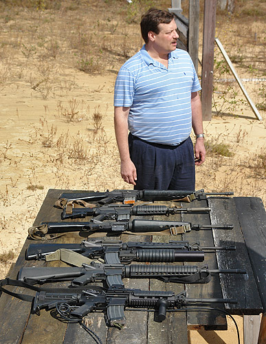 Dave with M16 rifles